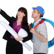 An architect and her plumber — Stock Photo