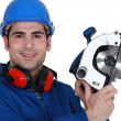 Carpenter with circular saw. — Stock Photo #14708193