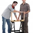 Stock Photo: Father and son working on carpentry project