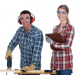 Stock Photo: Couple using electric jigsaw