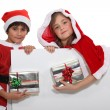 Brother and sister with Christmas gifts — Stock Photo