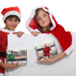 Royalty-Free Stock Photo: Brother and sister with Christmas gifts