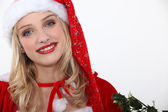 Young blond woman wearing Christmas disguise — Stock Photo