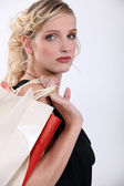 Glamorous woman with store bags — Stock Photo
