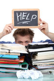 Student swamped under paperwork — Stock Photo