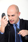 Furious man on the phone — Zdjęcie stockowe