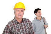 Senior laborer and young man — Stock Photo