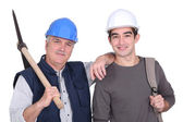 A mature construction worker and his grandson. — Стоковое фото