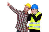Architect and foreman looking at a problem — Stock Photo