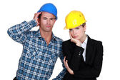 Annoyed construction worlers — Stock Photo