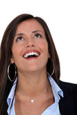 Businesswoman with look of amazement on face — Stock Photo