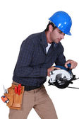 Tradesman using a circular saw — Stock Photo