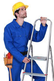 Manual worker with a stepladder — Stock Photo