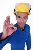 Closeup portrait of craftsman making ok sign — Stock Photo