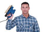 Carpenter holding electric sander — Stock Photo