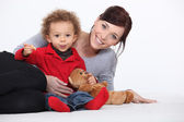 Mother, child and teddy bear — Stock Photo