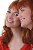 Portrait of beaming young woman with ginger hair — Stock Photo