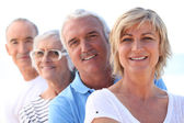 Two older couples standing in a line — Stock Photo
