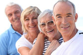 4 senior laughing — Stock Photo