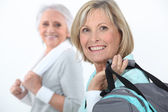 Mature women at fitness center — Stock Photo