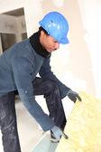 Worker preparing wall insulation — Stock Photo
