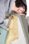 Worker handling insulation — Stock Photo