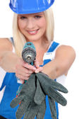 Tradeswoman aiming a screwdriver — Stock Photo