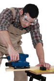 Joiner using sander — Stock Photo
