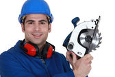 Carpenter with a circular saw. — Stock Photo