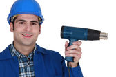 Male worker and an electric screwdriver — Stock Photo