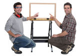 Duo of carpenters all smiles — Stock Photo