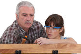 Builder and his apprentice — Stockfoto