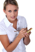 Young waitress with an order pad — Stock Photo