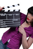 Young woman with cinema clap — Stock Photo
