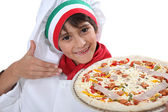 Young boy dressed as a pizza chef — Stock Photo