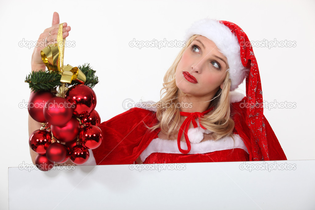 Mrs. Santa is in charge of Christmas decorations — Stock Photo #14701167
