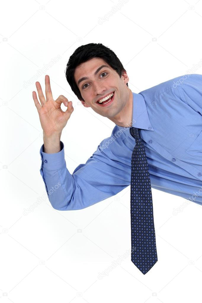 Enthusiastic man giving the a-ok sign — Stock Photo #14705343