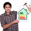 Stock Photo: Carpenter with engergy information panel