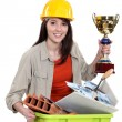 Female builder holding award for recycling — Stock Photo #14710571