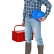 Craftsman standing with toolbox and safety helmet — Stock Photo