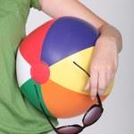 Faceless blonde holding a beach ball — Stock Photo #14711071