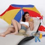 Woman laying on sun lounger — Stock Photo
