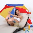Girl jumping on hammock with beach accessories — Stok Fotoğraf #14711179