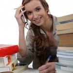 Smiling girl doing homework — Stock Photo