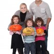 Family with Halloween jack-o — Stock Photo