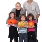 Family with Halloween jack-o — Stock Photo