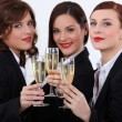 Three businesswomen drinking champagne — Stock Photo #14711487