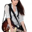 Female guitarist - Stockfoto