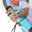 Father and son practising archery — Stock Photo #14712029