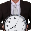 Smiling businessmwith clock — Stock Photo #14715093